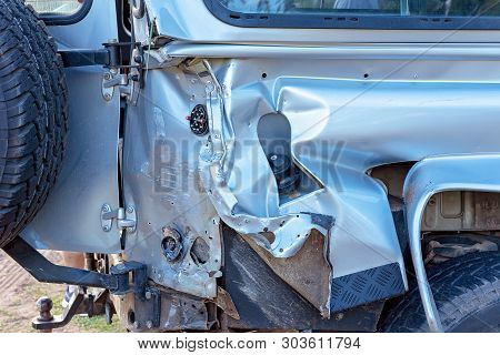 A Badly Damaged Four Wheel Drive Vehicle Involved In A Four Car Pileup On The Highway
