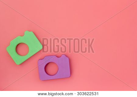 Photo Camera Concept On Pink Background Top View Mock Up