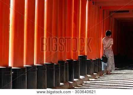 Fushimi Inari-taisha Shrine. Thousands Countless Vermilion Torii Gates With Red Japanese Lanterns, F