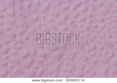 The Surface Of The Fine Compressed Paper Is Pink In Color As A Background. Excellent Relief Pattern