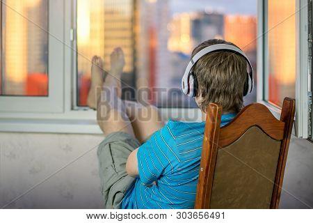 Guy In Headphones Are Audiophile Enjoying Life Listening To Music Sitting Upside Down In Big Headpho