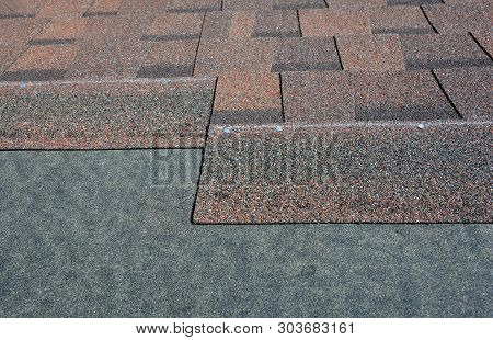 Roof Repair, Asphalt Shingles Roof Renovation . Close Up On Installing Roof Tiles, Laying Asphalt Sh