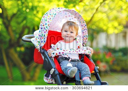 Cute Healthy Little Beautiful Baby Girl Sitting In The Pram Or Stroller And Waiting For Mom. Happy S