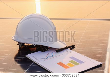 Engineers Are Examining The Performance Graph Of Energy Production From Solar Panels That Are Altern