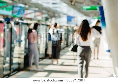 Blurred Of People Waiting On Electric Skytrain Station With Automatic Gateway