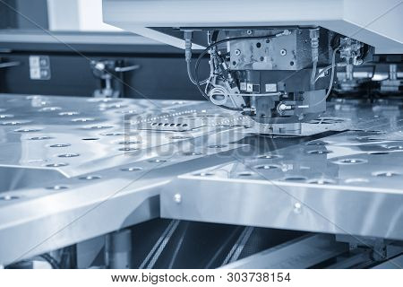 Turret Punching Machine Cutting The Metal  Plate. Metal Forming Machine.