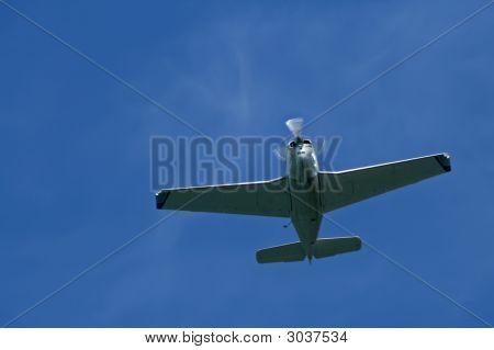 Lone Stunt Plane Flying Through The Sky