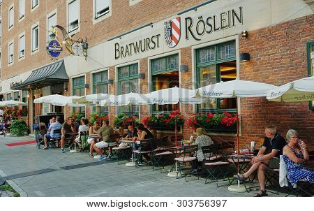 Exterior View Of People At Sidewalk Tables Outside Of The Famous