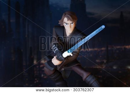 MAY 27 2019: Disney Infinity figurines depicting a scene from Star Wars The Clone Wars showing Jedi Anakin Skywalker with lightsaber drawn ready for action, Coruscant