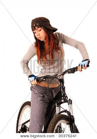 Portrait of young woman cyclist isolated on white, studio shot.