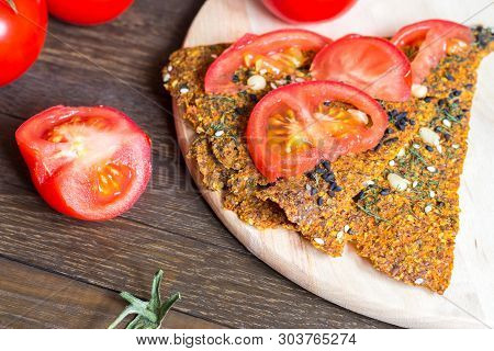 Delicious Quick Vegan Snack. Dehydrated Crisp Bread Loaves On Cutting Board And Tomato Slices On Woo