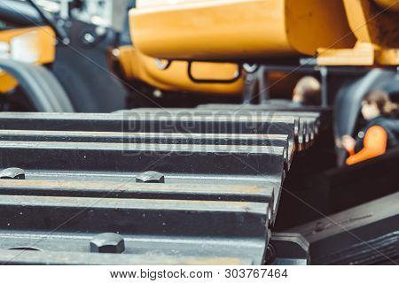 Hydraulics Of The Tractor Is Yellow. Caterpillar Iron Bulldozer