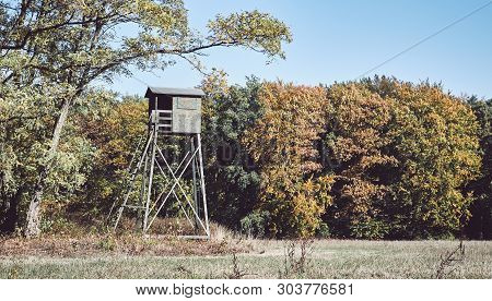 Wooden Deer Hunting Pulpit At The Edge Of A Forest And Field.