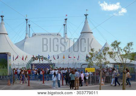 Malaga, Spain - June 10, 2018. The People Going Near Entrance To The Cirque De Soleil On Malaga City