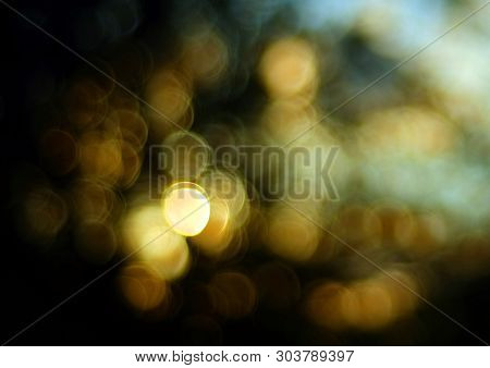 Beautiful Orange Sunset Bokeh Intentionally Blurred Out Of Focus To Creat A Dreamy Abstract Image.