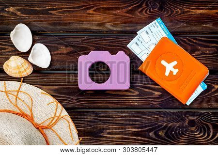 Camera, Hat, Passport And Tickets For Summer Photo At The Seaside On Wooden Background Top View