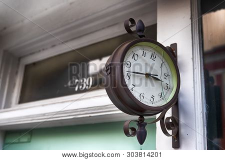 Abstract Building Wall With Antique Clock In Daylight