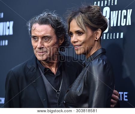 LOS ANGELES - MAY 15:  Ian McShane and Halle Berry arrives for the John Wick: Chapter 3 - Parabellum' L.A. Special Screening on May 15, 2019 in Hollywood, CA