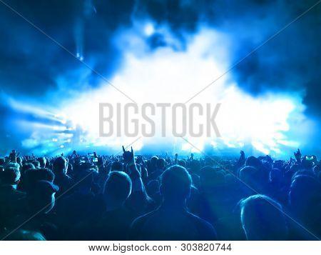 cheering concert crowd at rock concert
