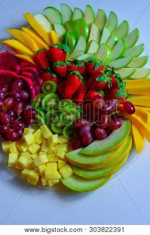 Fruit Platter With Fresh Grapes, Apple, Pineapple, Kiwi, Mango, Red Ripe Strawberry And Pitaya. Colo