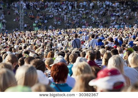 Large crowd of people watching concert or sport event poster