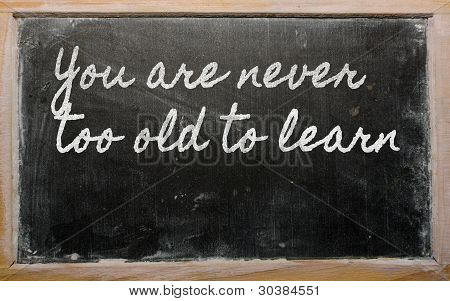 Expression -  You Are Never Too Old To Learn - Written On A School Blackboard With Chalk