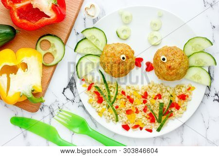 Funny Fish Meatballs With Vegetables And Porridge, Food Art Idea For Kids Lunch
