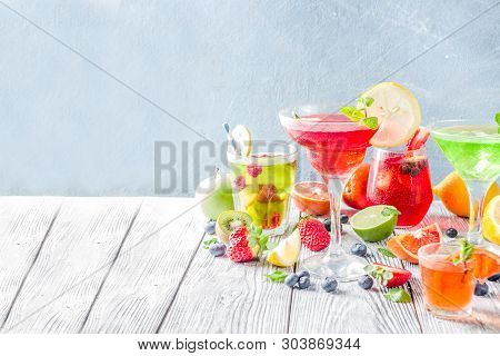 Selection Summer Fruit And Berry Cocktail Drinks. Wooden Background Copy Space