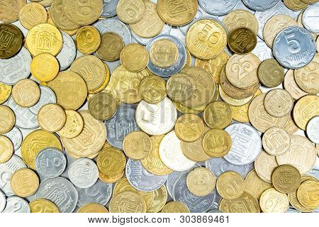 Old Golden And Silvery Coins From Ukraine. History Coins Texture Pattern Money Background. Top View