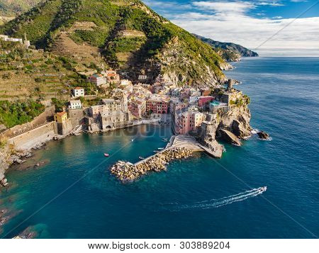 Aerial View Of Vernazza, One Of The Five Centuries-old Villages Of Cinque Terre, Located On Rugged N