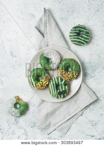 Vegan Doughnuts With Chia Seeds Topped With Healthy Matcha Tea Glaze With Pistachio, Desiccated Coco
