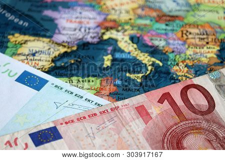 Euro Banknote On The Europe Map. Concept Of Eurozone, European Economy, Stock Market And Trading In