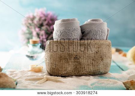 Spa And Wellness Setting With Sand, Star Fish And Towels. Dayspa Nature Products