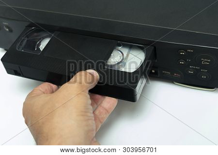 High Angle Shot On Video Tape Inserted In Vcr. Cctv Tape Recorder. Black Video Cassette Vhs Type Loa