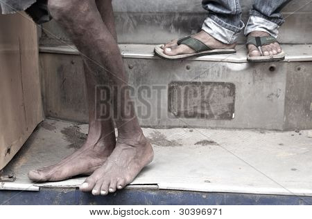 Dirty And Bare Man's Feet On Bus Step