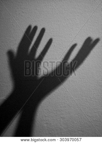 The sign of hope shadow of hand