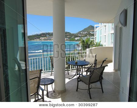 Beautiful Caribbean view looking out towards Westin Resort and dawn Beach as seen from Living Room leading to Balcony at Lighthouse 3C in Saint Martin poster