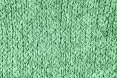 Loose Knitwear Fabric Texture with wool fibers. Repeating Machine Knitting Texture of warm Sweater. Trendy mint colored Knitted Background. poster