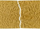 a background illustration of crumpled brown paper poster