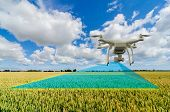 UAV drone multicopter flying with high resolution digital camera over a crops field scanning for problems, agriculture concept poster