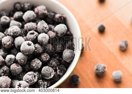 Frozen Frozen Berry Black Rowan Frozen Fruit. Top View, Flat Lay, Close Up.