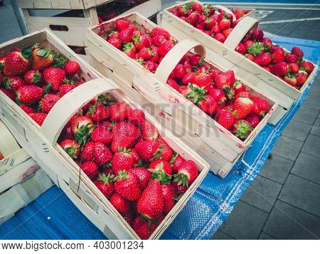 Many Fresh Strawberries In Boxes For Sale At A Fruit Market Outdoors. Top View. Healthy Food