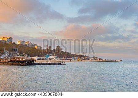 Black Sea, Beachs And Modern Seafront Building At Sunset. Odessa, Ukraine