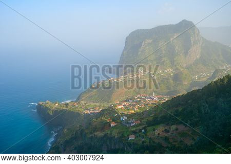 Landscape With Maderia Village, Mountains And Ocean. Madeira Island, Portugal