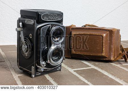 Zurich, Switzerland - December 31, 2020: Twin Lens Reflex Retro Camera Minolta Autocord With Its Bro