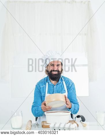 I Love My Job. Mature Bearded Man Wear Chef Hat Using Sieve. Male Cook Preparing Food In Home Kitche