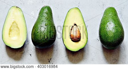 Healthy Food. Ripe Whole Green Avocado On A Gray Background. Flat Lay. Food Concept.  Top View. Gree