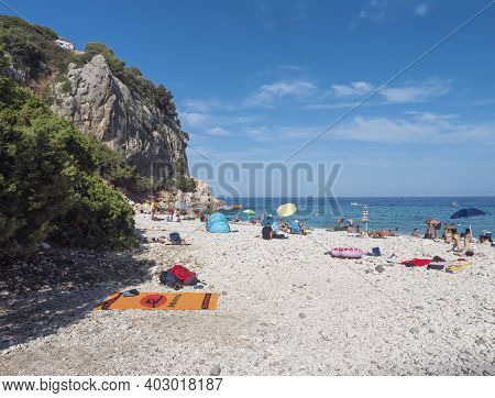 Cala Gonone, Sardinia, Italy, September 9, 2020: Cala Fuili Beach With Sunbathing People And Tourist