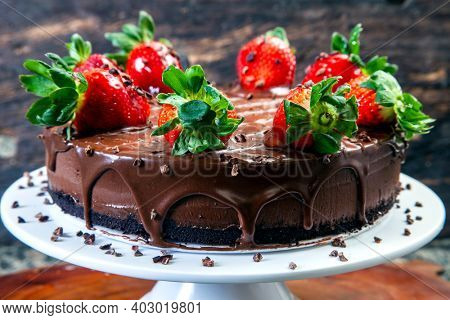 Chocolate cake with strawberry and dripping chocolate sauce