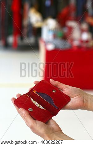 Red Purse Closeup Photo In Human Hands On Shopping Mall Background